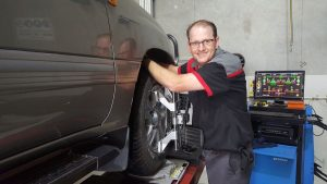 Photo Of A Mechanic Working On Tyre And Wheel Alignment