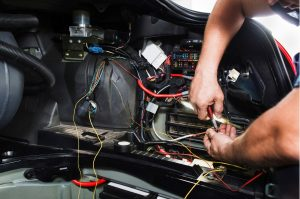 Mechanic Working On A Auto Electrical Service